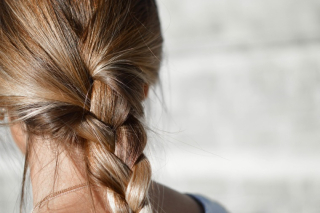 Woman with dirty-blonde hair in braid