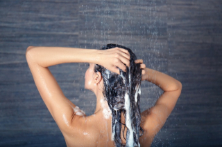 Woman washing hair in shower